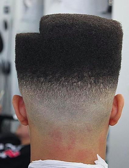 Un gran ejemplo de un tipo con el perfecto corte de pelo de alta desvanecimiento superior en forma con un paso en el cabello