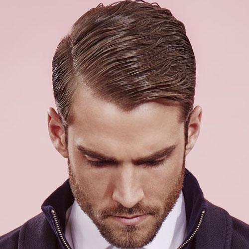 Hombres con clase del corte de pelo - Peinado de lado duro con la barba